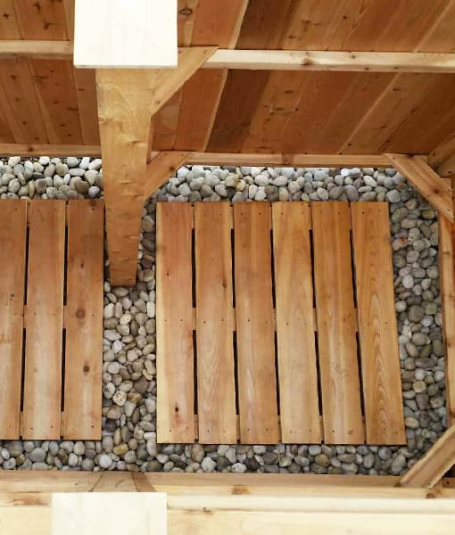 Use beach pebbles under your shower kit floor for drainage